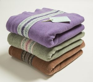 Why not snuggle by the fire with one of these soft, fairisle knitted blankets?